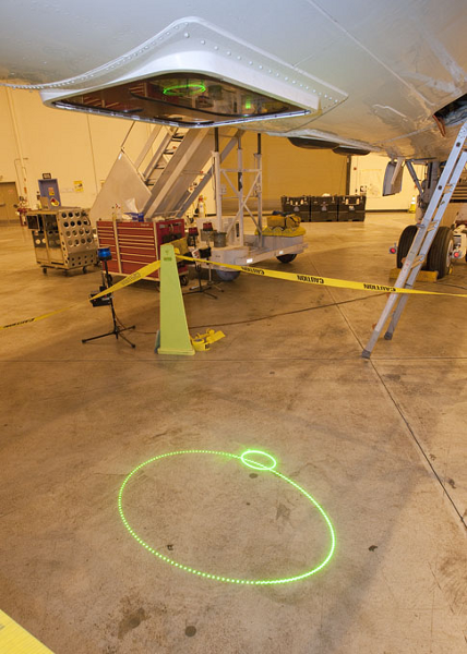 ATM laser trace on hangar floor