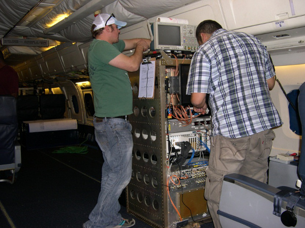 University of Kansas Fernando Rodriguez-Morales & Bryan Townley work the MCoRDS Radar instrument installation