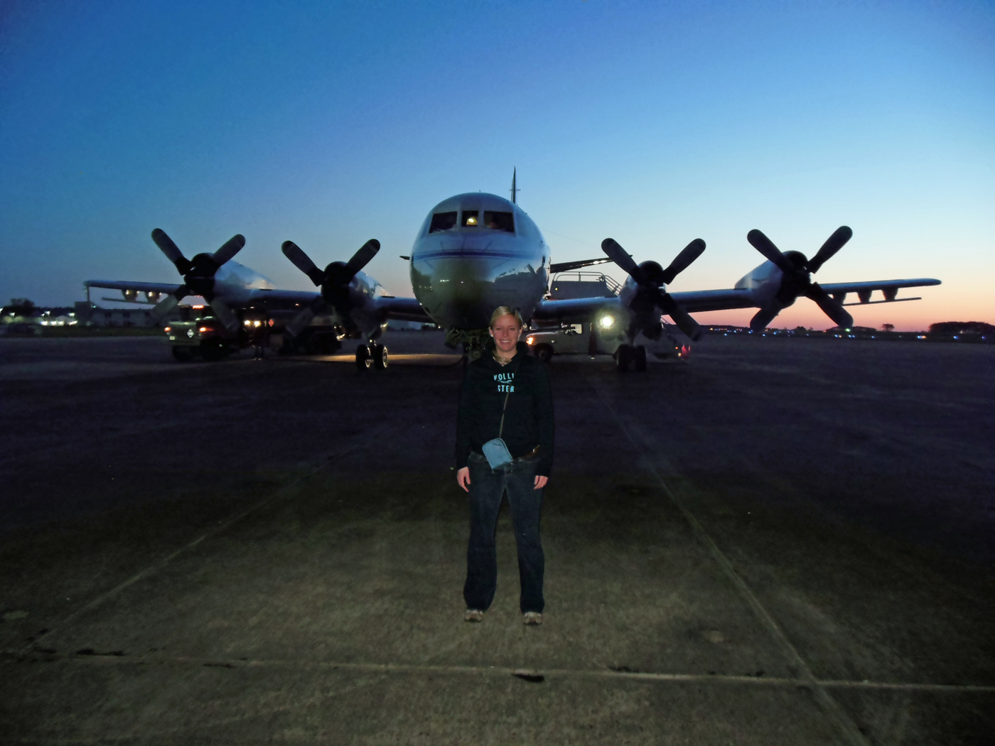 Christy Hansen stands in front of an airplane at Wallops Flight Facility in Virginia. This plane took her to Greenland this past April.