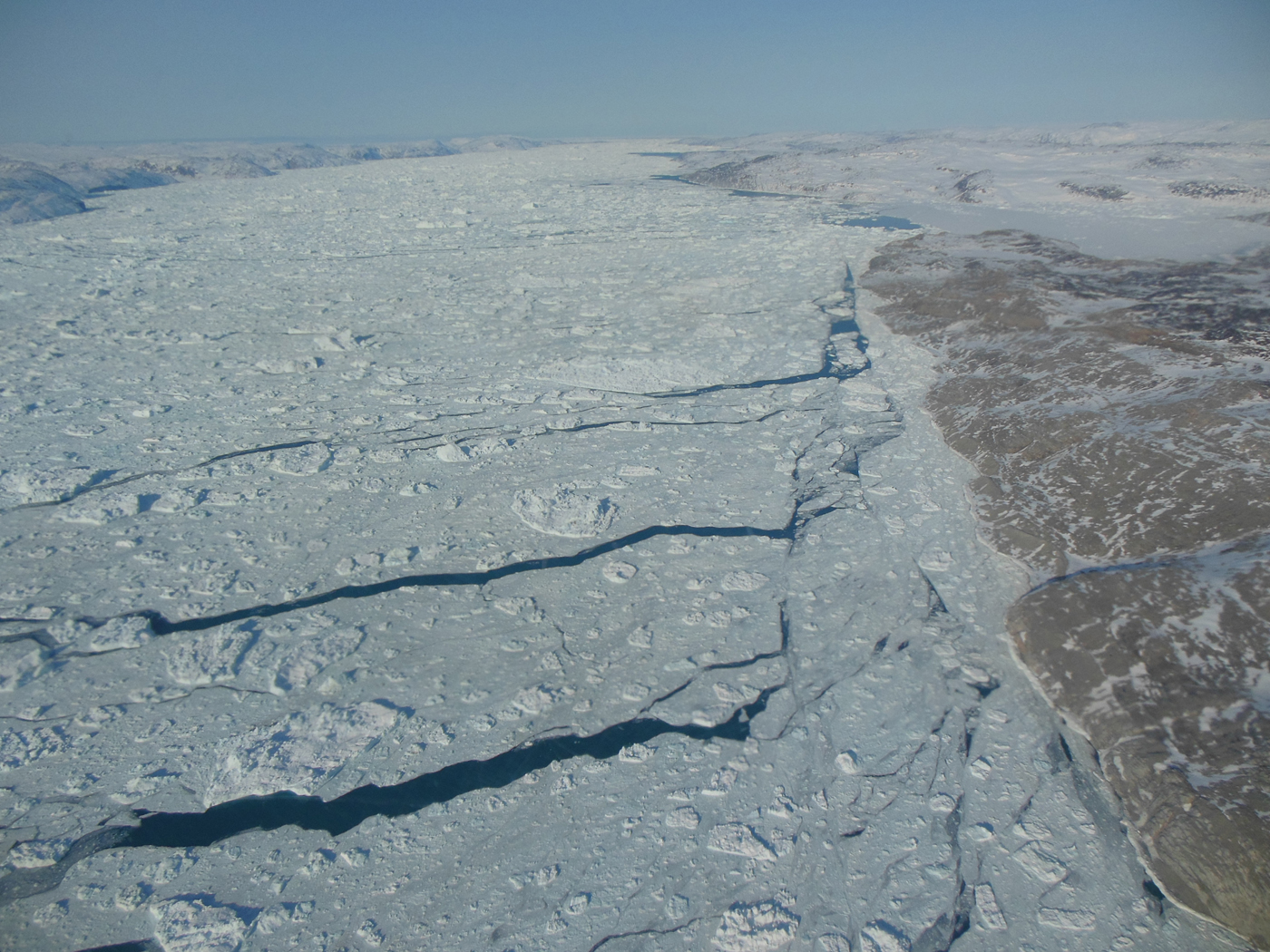A view of sea ice with open leads of water.