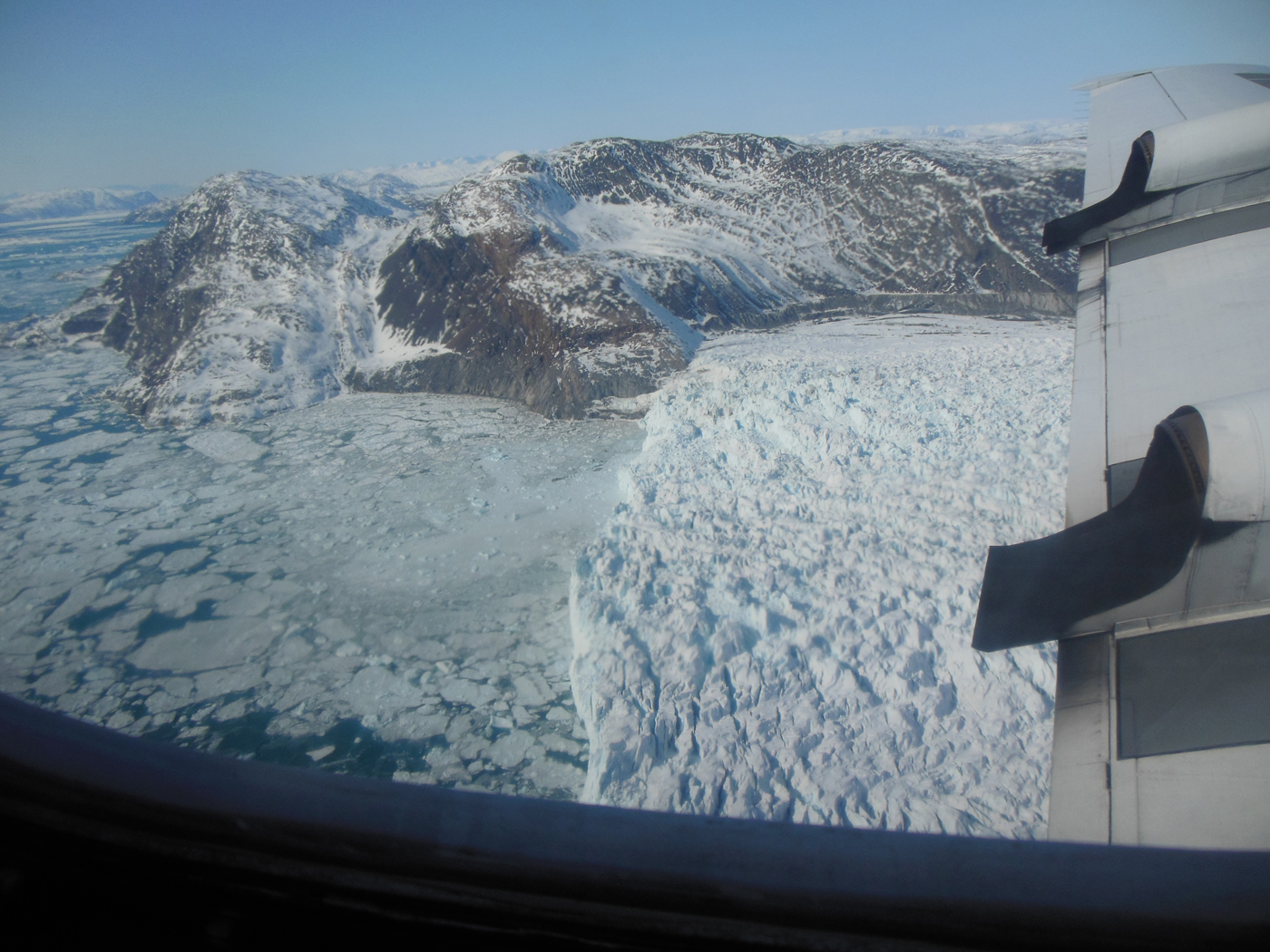 An image of a glacier's calving front, where it flows and loses ice to the sea.