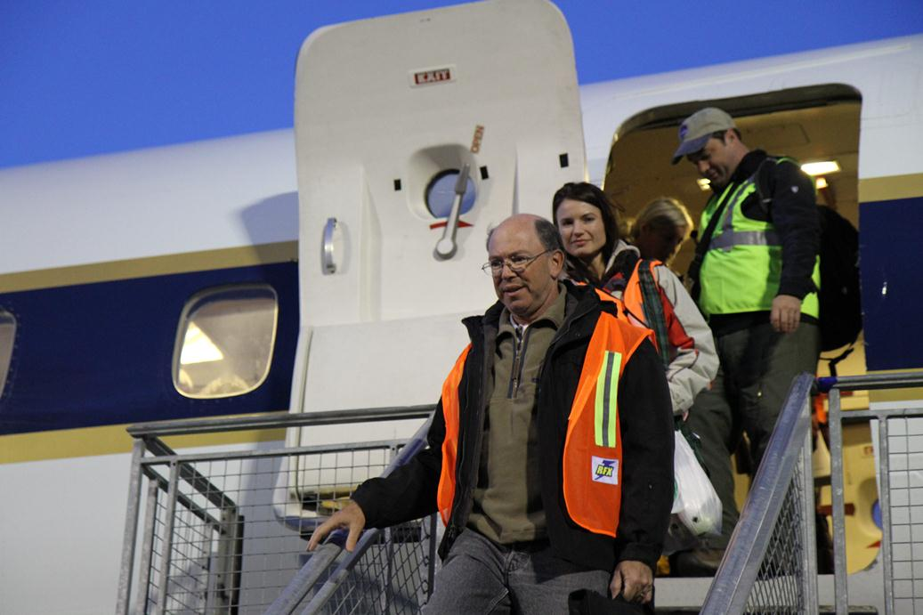 The ambassador and Ms. Jinnette exiting the DC-8 after another successful IceBridge survey flight.