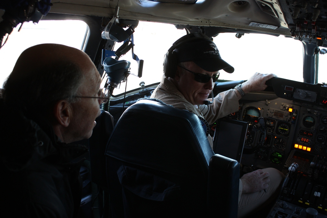 Ambassador Wolff in the DC-8 cockpit shortly after takeoff on Oct. 25.
