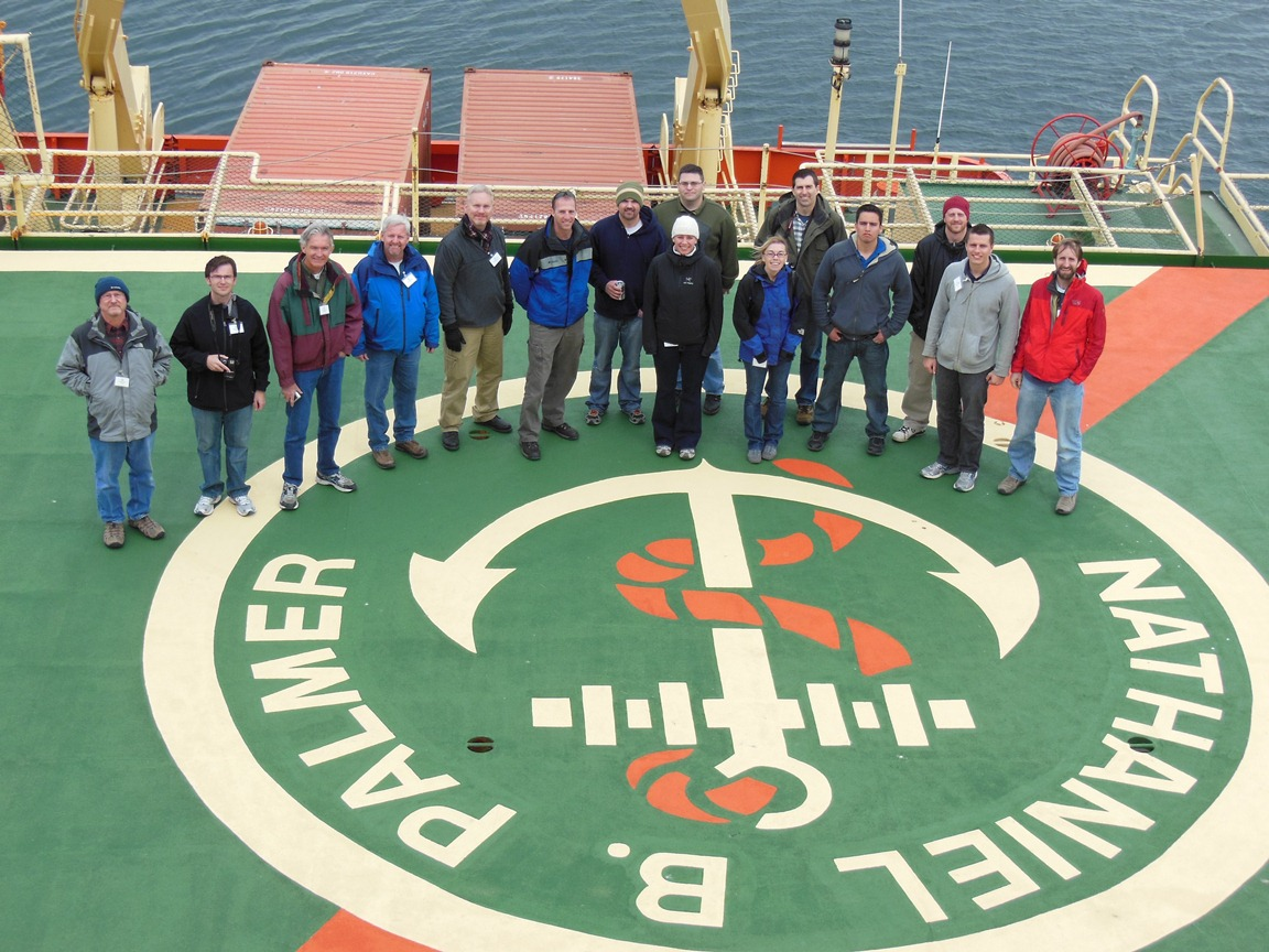 Palmer visitors stand on the helipad on the Palmer's stern