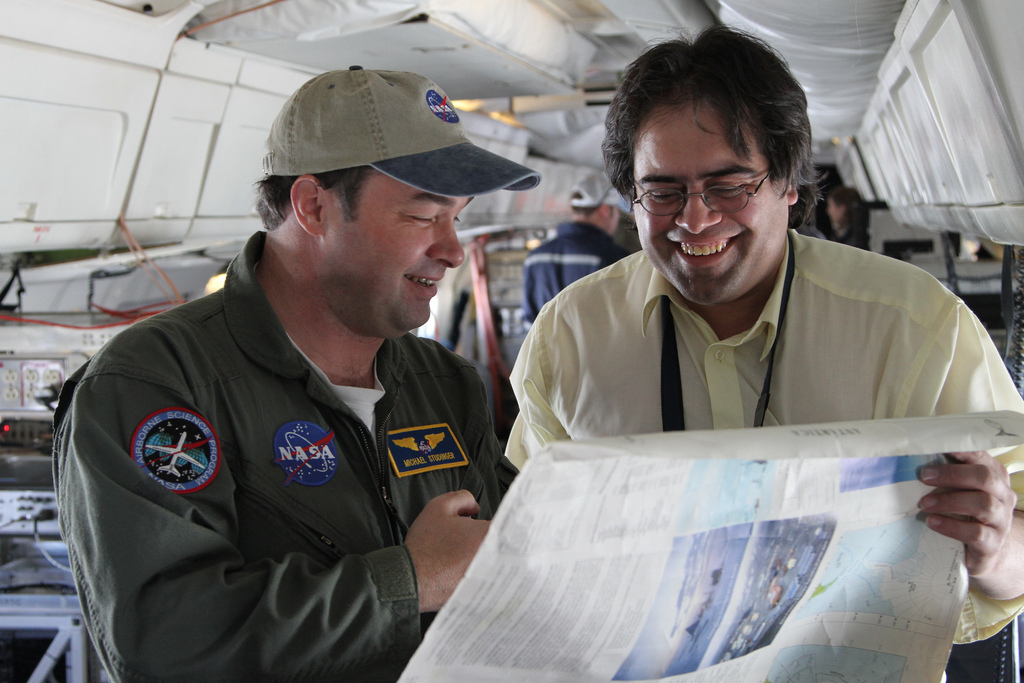 IceBridge project scientist Michael Studinger and Chilean teacher Mario Esquivel looking at a map on the NASA DC-8