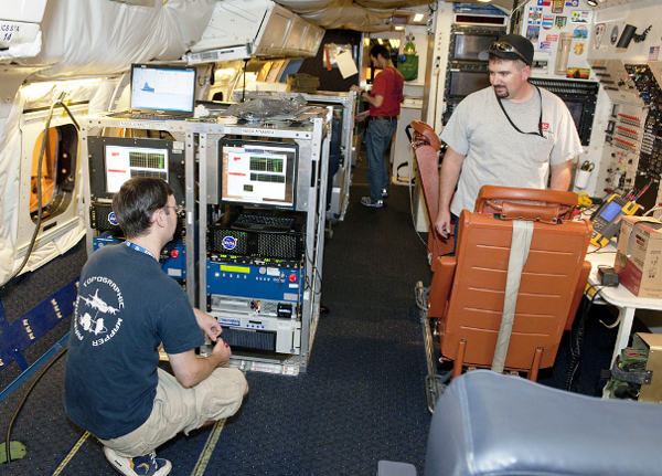 Avionics technician Brad Grantham (right) and Airborne Topographic Mapper team members Matt Linkswiler and Robert Harpold prepare instruments for the IceBridge campaign.