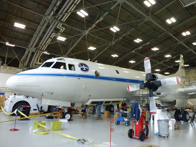 NASA's P-3B airborne laboratory in a hangar at Wallops Flight Facility as it is being prepared for the upcoming Arctic campaign.