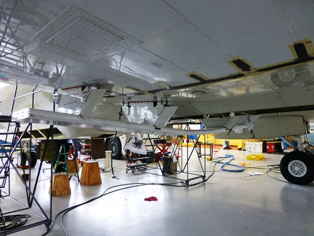 The MCoRDS antenna secured to the underside of the P-3B.