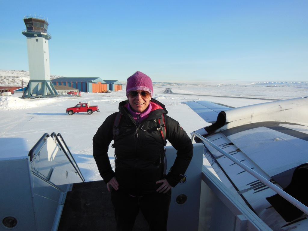 IceBridge project manager Christy Hansen on the stairway to NASA's P-3B.