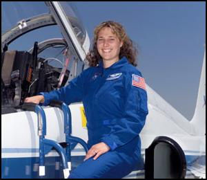 Astronaut Dottie Metcalf-Lindenburger poses beside a T-38 jet trainer