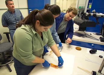 Torey Long and coworkers in the failure analysis lab