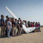 NASA Armstrong interns wearing eclipse glasses and standing with the PRANDTL glider